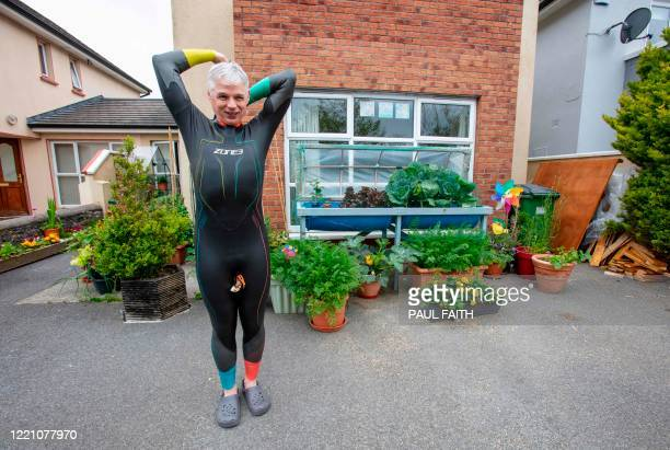 Irish Paralympic hopeful Leo Hynes who is legally blind puts on his wetsuit to train in his homemade training pool at home in Tuam Co Galway west...