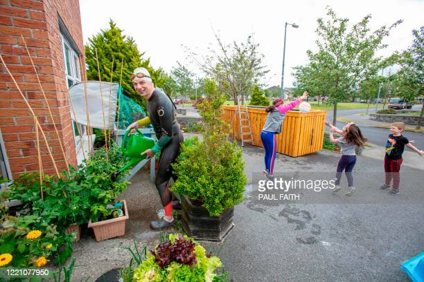 Irish Paralympic hopeful Leo Hynes who is legally blind takes a break from training to water his plants at his home in Tuam Co Galway west Ireland on...