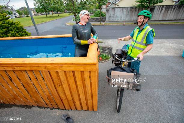 Irish Paralympic hopeful Leo Hynes who is legally blind talks to the local postal worker passing by his homemade training pool at home in Tuam Co...