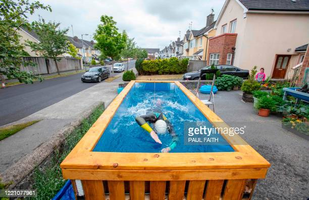TOPSHOT Irish Paralympic hopeful Leo Hynes who is legally blind trains in his homemade training pool in his front garden at home in Tuam Co Galway...