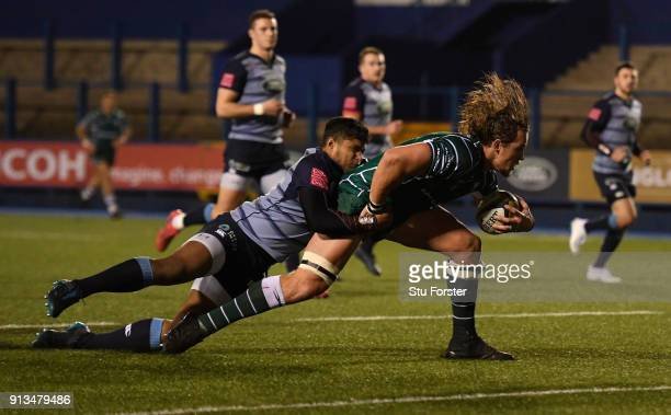 Irish player Arno Botha goes over for the third Irish try despite the attentions of Blues wing Corey Howells during the AngloWelsh Cup match between...
