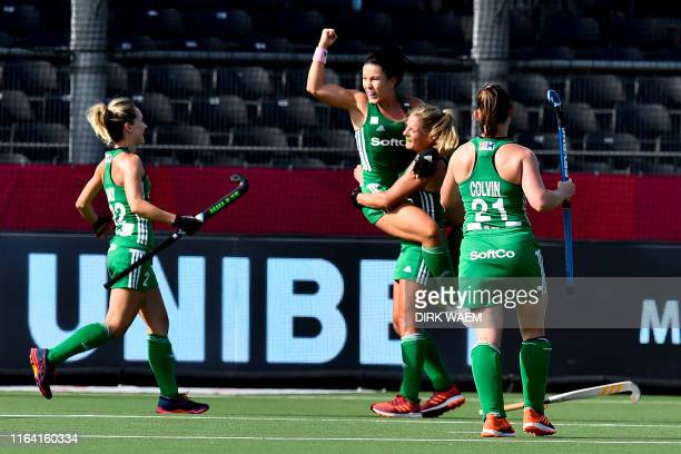 Irish players celebrate after scoring during a hockey game between Belgian women's national team The Red Panthers and Ireland a ranking game in group...