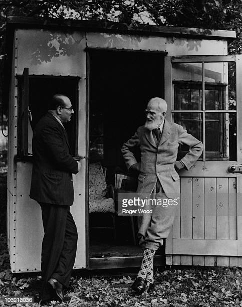 Irish playwright George Bernard Shaw chats with his biographer Dr F E Loewenstein outside his writing shed at home in Shaw's Corner Ayot St Lawrence...
