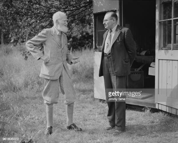 Irish playwright George Bernard Shaw in the garden of his home Shaw's Corner in Ayot St Lawrence Hertfordshire with his bibliographer Fritz Erwin...