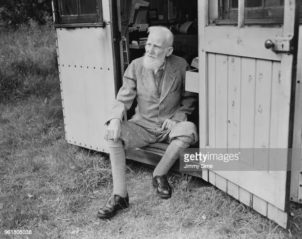 Irish playwright George Bernard Shaw on the doorstep of his 'Retreat' a wooden shed in the garden of his home Shaw's Corner in Ayot St Lawrence...