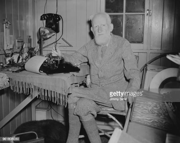 Irish playwright George Bernard Shaw typing in his 'Retreat' a wooden shed in the garden of his home Shaw's Corner in Ayot St Lawrence Hertfordshire...
