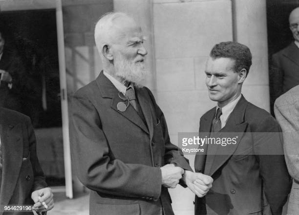 Irish playwright George Bernard Shaw with director Anthony Asquith during a lunch at Pinewood Studios UK circa 1938 Asquith is beginning work on a...