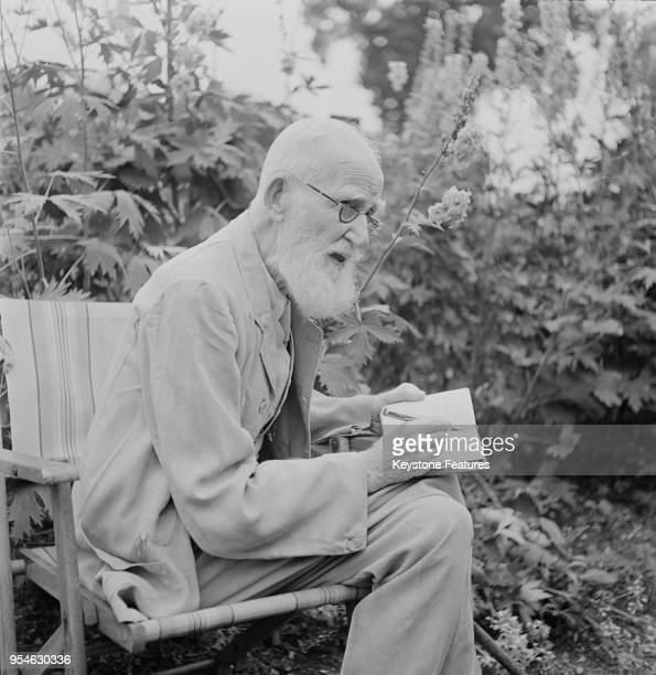 Irish playwright George Bernard Shaw writing in the garden of his home Shaw's Corner in Ayot St Lawrence Hertfordshire July 1946
