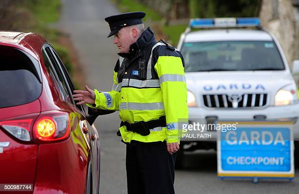 Irish police officer James O'Donoghue operates a checkpoint near a Christmas tree farm in Wicklow south of Dublin on December 10 2015 Fed up with...
