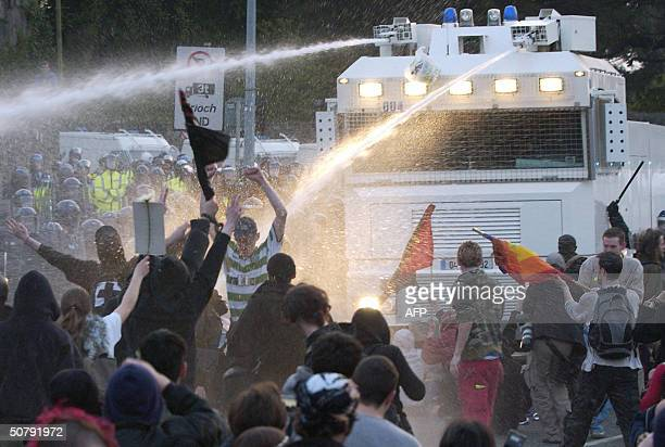 Irish police use a water cannon to disperse a crowd of demonstrators outside Pheonix Park in Dublin 01 May 2004 where the EU expansion ceremonies...