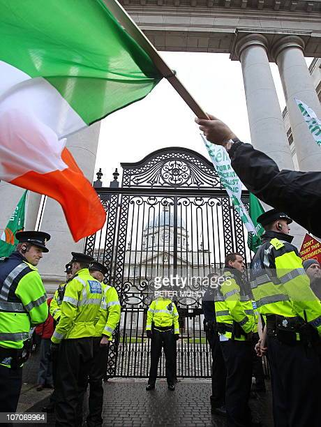 Irish policemen guard the front gates to the Irish Prime Ministers office in Dublin Ireland on November 22 2010 Ireland was Monday hammering out the...