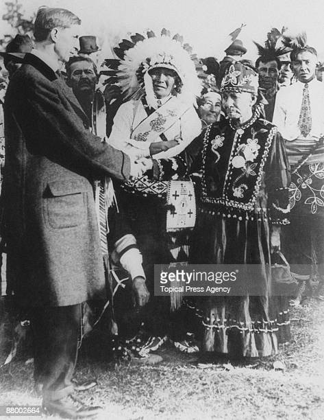 Irish politician and president of Dail Eireann Eamon de Valera shakes hands with Native Americans during a visit to the USA 1919