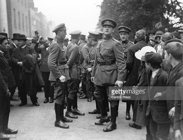 Irish politician and Sinn Fein leader Michael Collins and K O'Higgins attend the funeral of the Irish Free Stater and founder of Sinn Fein Arthur...