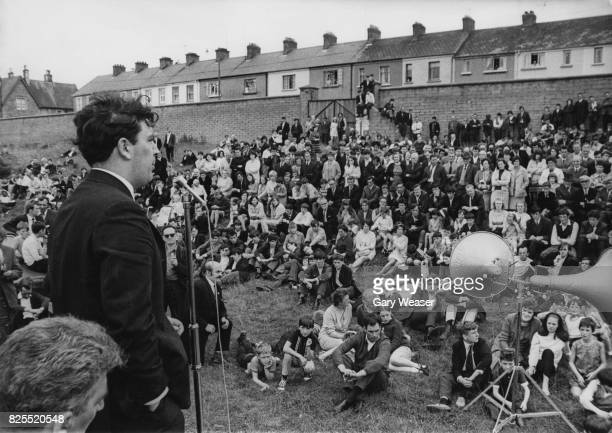 Irish politician John Hume addresses a Catholic meeting at the Celtic Park football ground in Londonderry Northern Ireland before a parade by the...