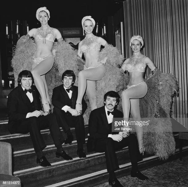 Irish pop group The Bachelors with showgirls at London Hippodrome UK 2nd March 1971 Not in order Declan 'Dec' Cluskey Conleth 'Con' Cluskey John...