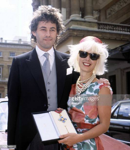 Irish Pop Musician Bob Geldof Member of 'The Boomtown Rats' and his wife PAULA YATES British TV Presenter Outside Buckingham Palace after receiving...
