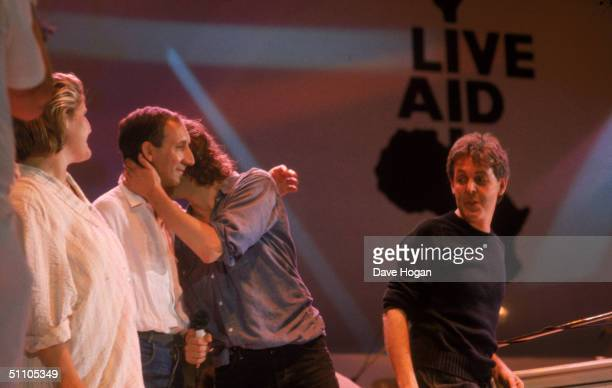 Irish pop singer and Live Aid organiser Bob Geldof whispers to The Who's Pete Townshend at the Live Aid charity concert Wembley Stadium London 13th...