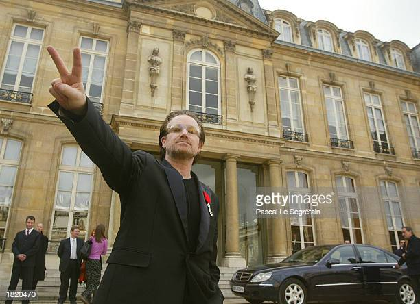 Irish pop star Bono flashes a peace sign in the courtyard of the Elysee Palace February 28 2003 in Paris Bono will meet with French President Jacques...