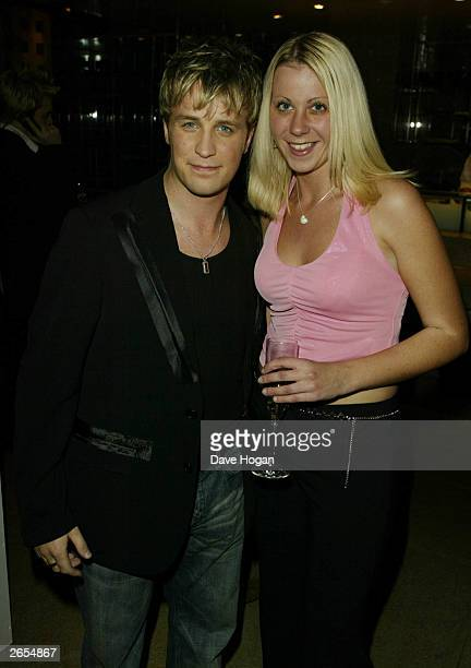 "Irish pop star Kian Egan and his friend attend Westlife's ""Unbreakable"" album launch at the Zuma Restaurant on November 11, 2002 in London."