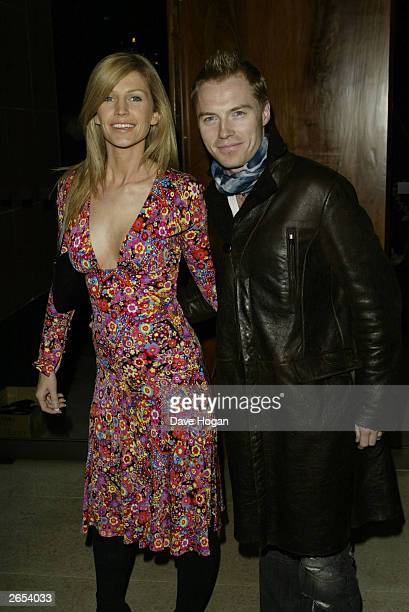 """Irish pop star Ronan Keating and his wife attend Westlife's """"Unbreakable"""" album launch at the Zuma Restaurant on November 11, 2002 in London."""