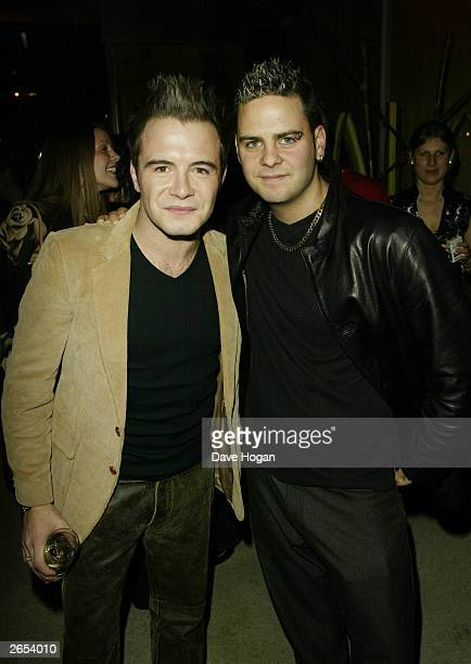 """Irish pop star Shane Filan and his friend attend Westlife's """"Unbreakable"""" album launch at the Zuma Restaurant on November 11, 2002 in London."""
