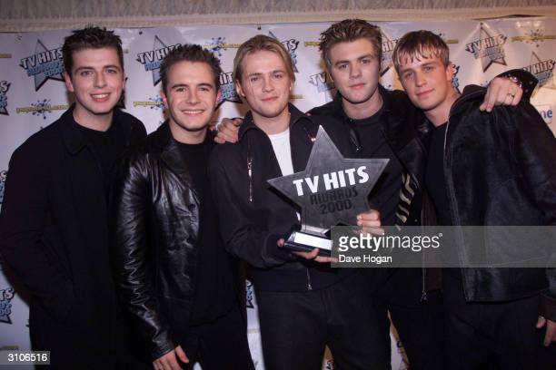 Irish pop stars Mark Feehily Shane Filan Nicky Byrne Bryan McFadden and Kian Egan of the pop group Westlife attend the TV Hits Awards held at Wembley...
