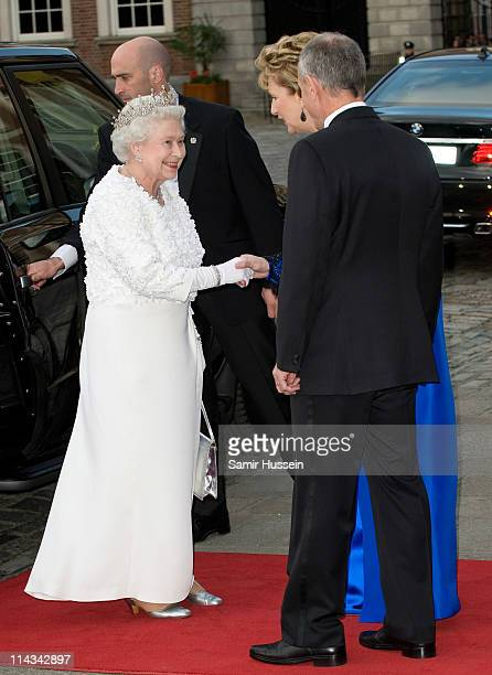 Irish President Mary McAleese and her husband Martin McAleese greet Queen Elizabeth II as she arrives for a State Banquet in Dublin Castle with Irish...