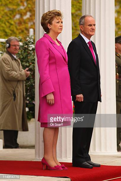 Irish President Mary McAleese and her husband Martin McAleese listen to the Irish and UK national anthems as Queen Elizabeth II visits at the Aras an...