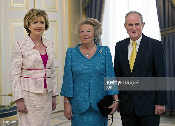 Irish president Mary McAleese and her husband Martin McAleese visit Queen Beatrix at palace Noordeinde in The Hague on May 3 2011 AFP PHOTO/ANP ROYAL...