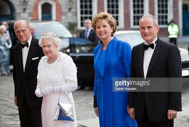 Irish President Mary McAleese and husband Martin McAleese greet Queen Elizabeth II and Prince Philip, Duke of Edinburgh as they arrive for a State...