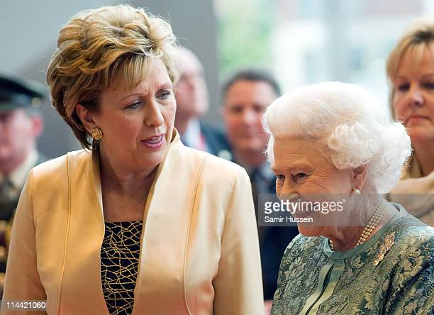 Irish President Mary McAleese and Queen Elizabeth II attend a fashion and arts show at the Convention Centre on May 19 2011 in Kildare Ireland The...