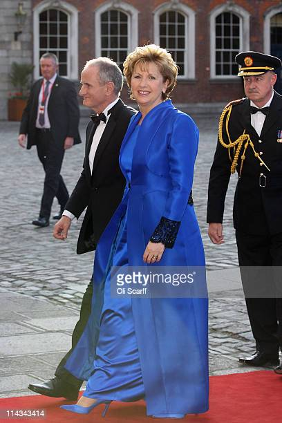 Irish President Mary McAleese arrives with her husband Martin McAleese to attend a State Banquet in Dublin Castle on May 18, 2011 in Dublin, Ireland....