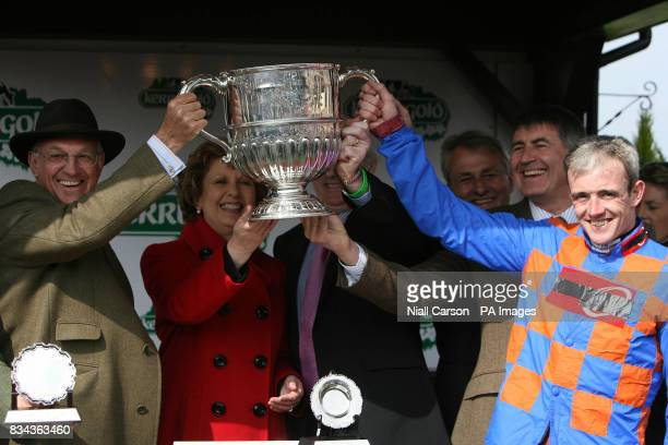 Irish President Mary McAleese congratulates Ruby Walsh after riding Twist Magic to victory in the Kerrygold Champion Steeplechase during the 2008...