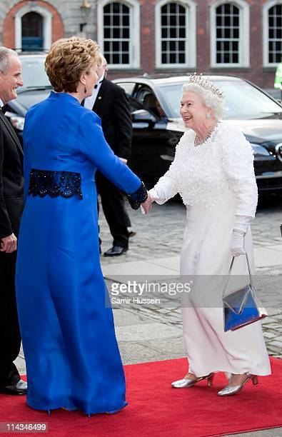 Irish President Mary McAleese greets Queen Elizabeth II as she arrives for a State Dinner on May 18, 2011 in Dublin, Ireland. The Duke and Queen's...