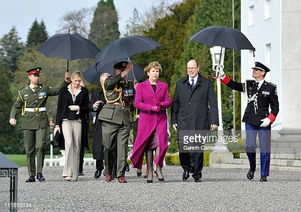 Irish President Mary McAleese His Serene Highness Prince Albert II Of Monaco and his fiancee Charlene Wittstock attend a ceremonial welcome and tree...