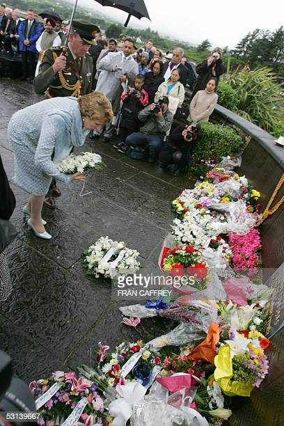 Irish President Mary McAleese lays a wreath 23 June 2005 at Ahakista at the memorial ceremony marking the twentieth anniversary of the Air India...