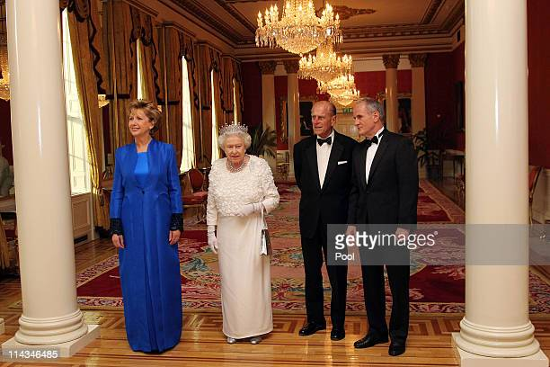 Irish President Mary McAleese, Queen Elizabeth II, Prince Philip, Duke of Edinburgh and Dr. Martin McAleese attend a State Dinner at Dublin Castle,...