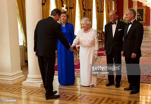 Irish President Mary McAleese, Queen Elizabeth II, Prince Philip, Duke of Edinburgh and Martin McAleese greet Prime Minister David Cameron attend a...