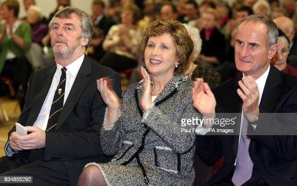 Irish President Mary McAleese with her Husband Dr Martin McAleese and Seamus Ennis , Chairman of St Josephs, Ballycran Hurling Club in Co Down.