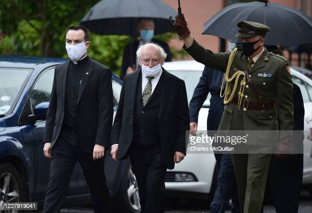 Irish President Michael D Higgins arrives as the funeral takes place of former SDLP leader and Nobel Peace Prize winner John Hume at St Eugenes...