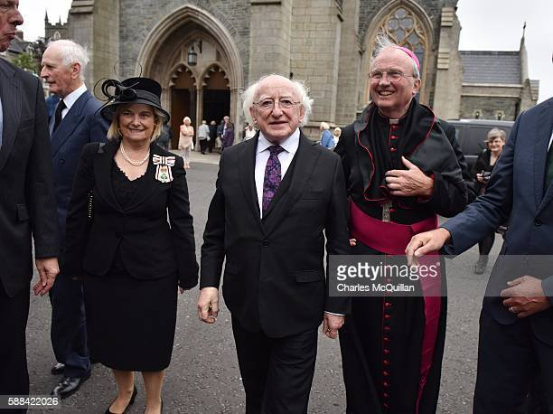 Irish President Michael D Higgins arrives for the funeral of the late retired Bishop of Derry Dr Edward Daly as he lies in state at St Eugene's...