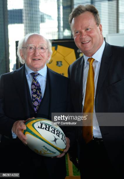 Irish President Michael D Higgins holds a rugby ball with Australian Rugby Union CEO Bill Pulver at the ARU headquarters in Sydney on October 18 2017...