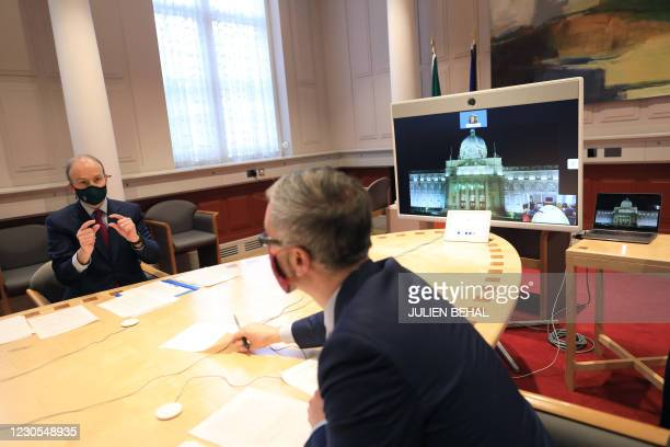 Irish Prime Mininster Micheal Martin with Children's Minister Roderic O'Gorman holds a live video link with survivors and stakeholders upon...