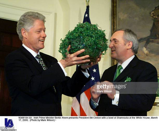 Irish Prime Minister Bertie Ahern presents President Bill Clinton with a bowl of Shamrocks at the White House March 17 2000