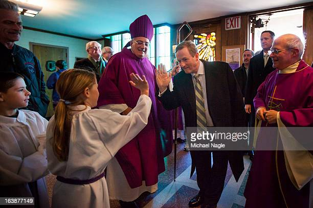 Irish Prime Minister Enda Kenny flanked by Rev Nicholas DiMarzio Bishop of Brooklyn and Monsignor Michael J Curran pastor of St Thomas More Church...