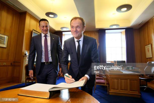 Irish Prime Minister Leo Varadkar accompanies President of the European Council Donald Tusk as Tusk signs the visitor's book at the Government...