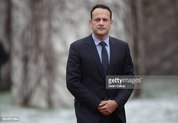Irish Prime Minister Leo Varadkar and German Chancellor Angela Merkel prepare to review a guard of honor upon Vardkar's arrival at the Chancellery on...