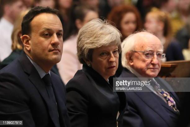 TOPSHOT Irish Prime minister Leo Varadkar Britain's Prime Minister Theresa May and Irish President Michael D Higgins attend the funeral service of...