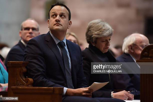 Irish Prime minister Leo Varadkar Britain's Prime Minister Theresa May and Irish President Michael D Higgins attend the funeral service of journalist...