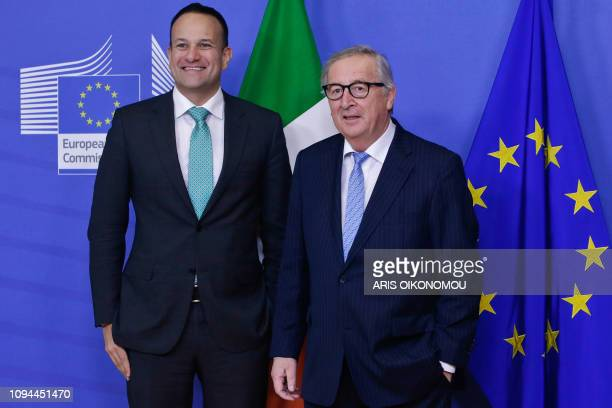 Irish Prime Minister Leo Varadkar poses with European Commission President JeanClaude Juncker at the European Commission headquarters in Brussels on...